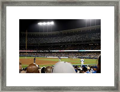 Watching The Game Framed Print by Malania Hammer