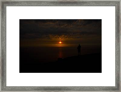 Watching The Sunset Framed Print by Paul Howarth