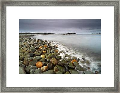 Ancient Stones And Serene Sea Framed Print