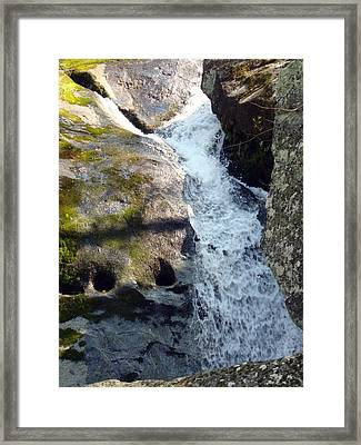 Water Carving Faces In Stone Framed Print