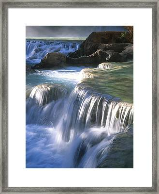Water Flowes Over Travertine Formations Framed Print by Bill Hatcher
