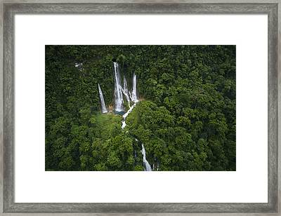 Waterfalls Pour Out Of Mageni Cave Framed Print