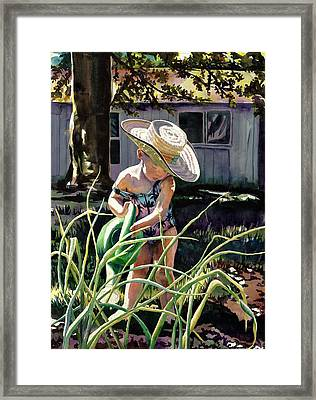 Watering The Onions Framed Print