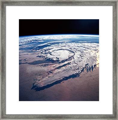 Weather Systems Above Earth Framed Print by Stockbyte