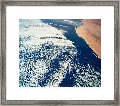 Weather Systems Above The Earth Viewed From Space Framed Print