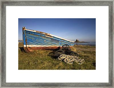 Weathered Fishing Boat On Shore, Holy Framed Print