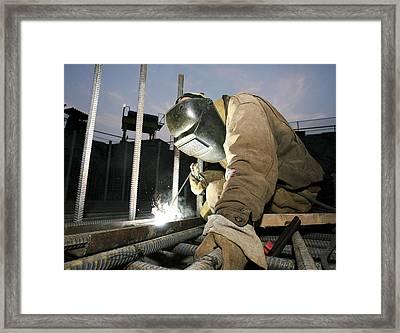 Welder Working On A New Bridge Framed Print