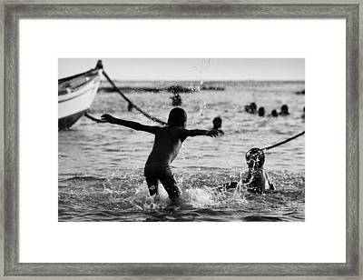 Wet Games Framed Print by Victor Bezrukov