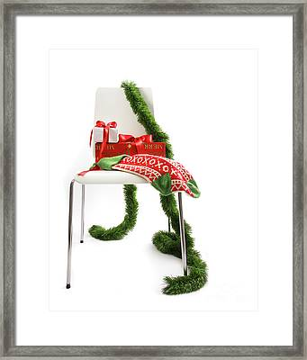 White Chair With Gifts And Garland On White  Framed Print by Sandra Cunningham