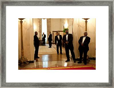 White House Butlers Watch As President Framed Print