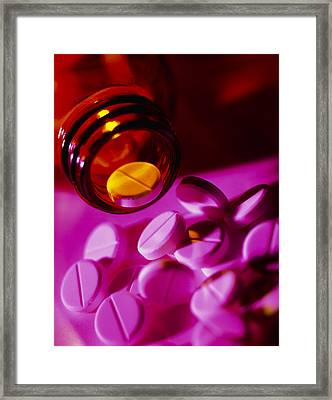 White Pills Spilling Out Of Their Bottle Framed Print by Tek Image