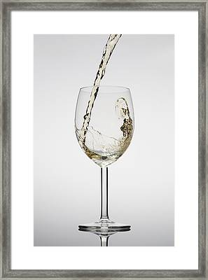 White Wine Being Poured Into A Glass Framed Print by Dual Dual