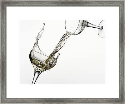 White Wine Pouring From One Glass Into Another Framed Print