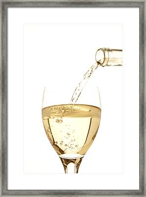 White Wine Pouring Into A Glass Framed Print by Ross Durant Photography