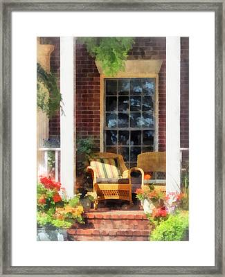 Wicker Chair With Striped Pillow Framed Print
