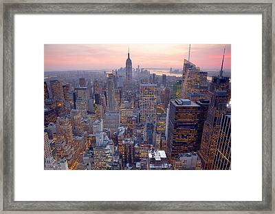 Wide View Of City Buildings Framed Print by Grant Faint