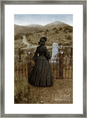 Widow At The Cemetery Framed Print
