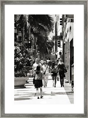 Wilshire Walkers Framed Print by Ricky Barnard