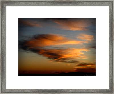 Wind Blown Sunset Sunset Clouds Over Mount Taylor Framed Print by Aaron Burrows