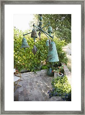Wind Chimes In Garden Framed Print by Andersen Ross