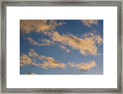 Framed Print featuring the photograph Wind Driven Clouds by Mick Anderson