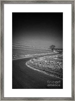 Winding B Road Through The Derbyshire Dales Peak District National Park In Derbyshire England Uk Framed Print by Joe Fox