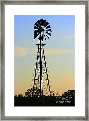 Framed Print featuring the photograph Windmill At Dusk by Kathy  White
