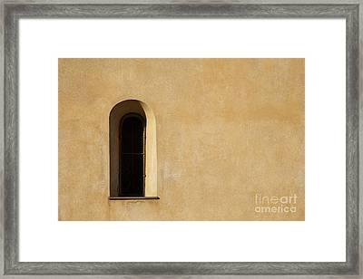 Window And Stucco Framed Print