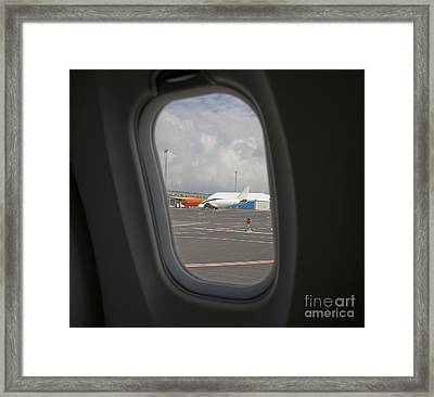 Window View On An Airplane Framed Print