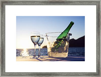Wine Glasses And Bottle Outdoors Framed Print