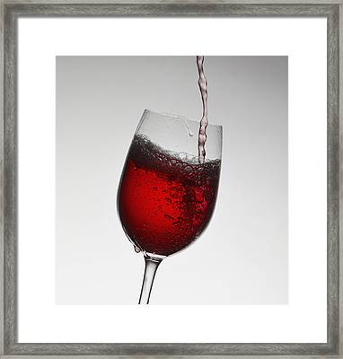 Wine Pouring Into Wine Glass Framed Print