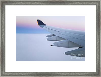 Wing And Engines Of Jet In Flight Framed Print by Jeremy Woodhouse