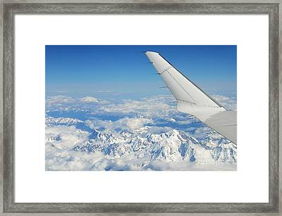 Wings Of Flying Airplane Over French Alps Framed Print by Sami Sarkis