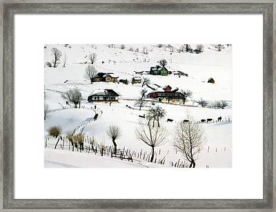 Winter In The Village Framed Print by Emanuel Tanjala