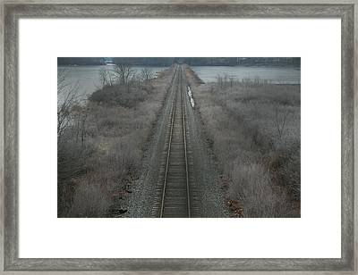 Framed Print featuring the photograph Winter Tracks  by Neal Eslinger