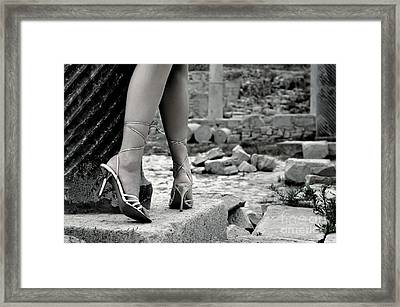 Woman Among Remains Of An Ancient Temple Framed Print by Oleksiy Maksymenko
