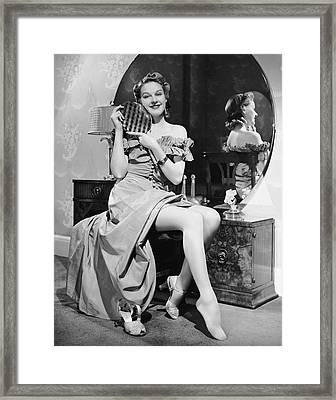 Woman At Dressing Table Holding Mirror Framed Print by George Marks
