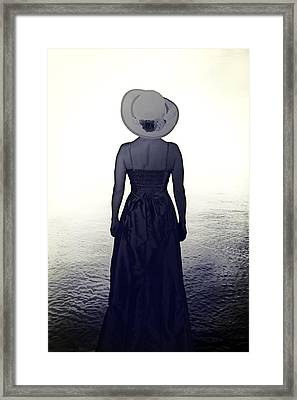Woman At The Shore Framed Print