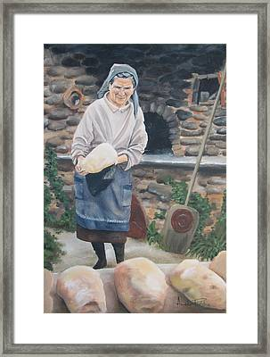 Woman Baking Bread  Framed Print by Anna Poelstra Traga