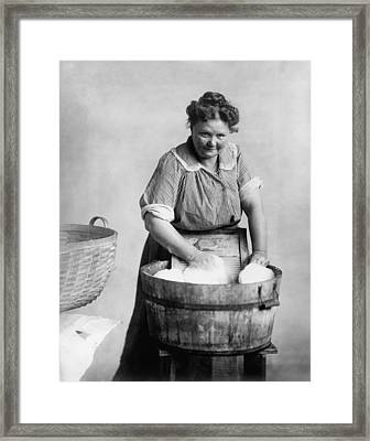 Woman Doing Laundry In Wooden Tub Framed Print by Everett