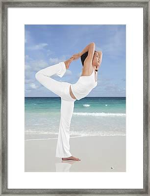 Woman Doing Yoga On The Beach Framed Print by Setsiri Silapasuwanchai