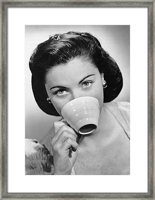 Woman Drinking From Cup Framed Print by George Marks