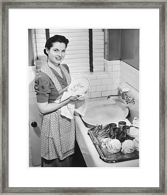 Woman Drying Dishes At Kitchen Sink, (b&w), Elevated View Framed Print by George Marks