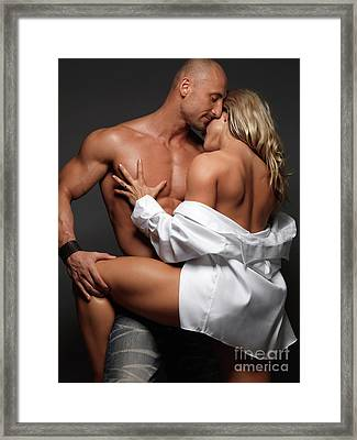 Woman Embracing A Muscular Man Framed Print by Oleksiy Maksymenko