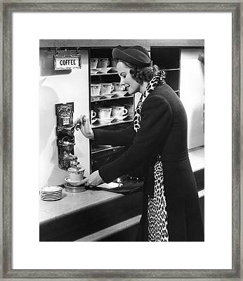 Woman Getting Coffee At Old Fashioned Machine Framed Print by George Marks