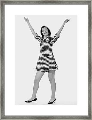 Woman Holding Arms Up In The Air Framed Print by George Marks