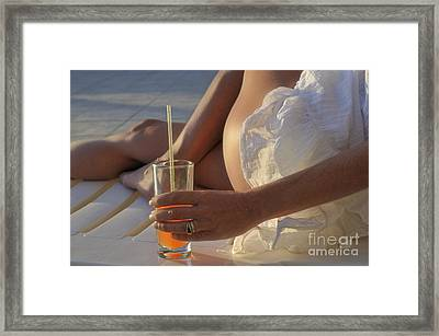 Woman Holding Cocktail Glass While Sunbathing Framed Print by Sami Sarkis