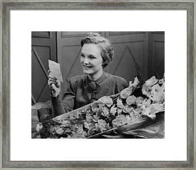 Woman Holding Flower Arrangement, Reading Card, (b&w) Framed Print by George Marks