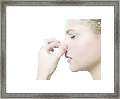 Woman Holding Her Nose Framed Print