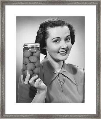 Woman Holding Jar Of Fruit Framed Print by George Marks